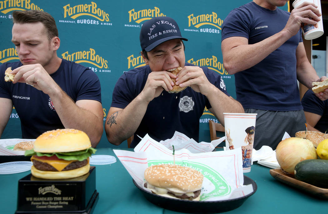 Clark County firefighter Shane Salmon, left, and his teammates compete with Las Vegas firefight ...