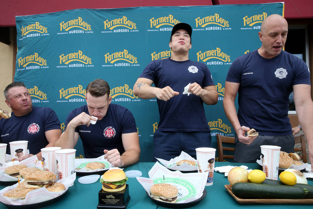 Clark County firefighters, from left, Erik Oliver and Shane Salmon compete with Las Vegas firef ...