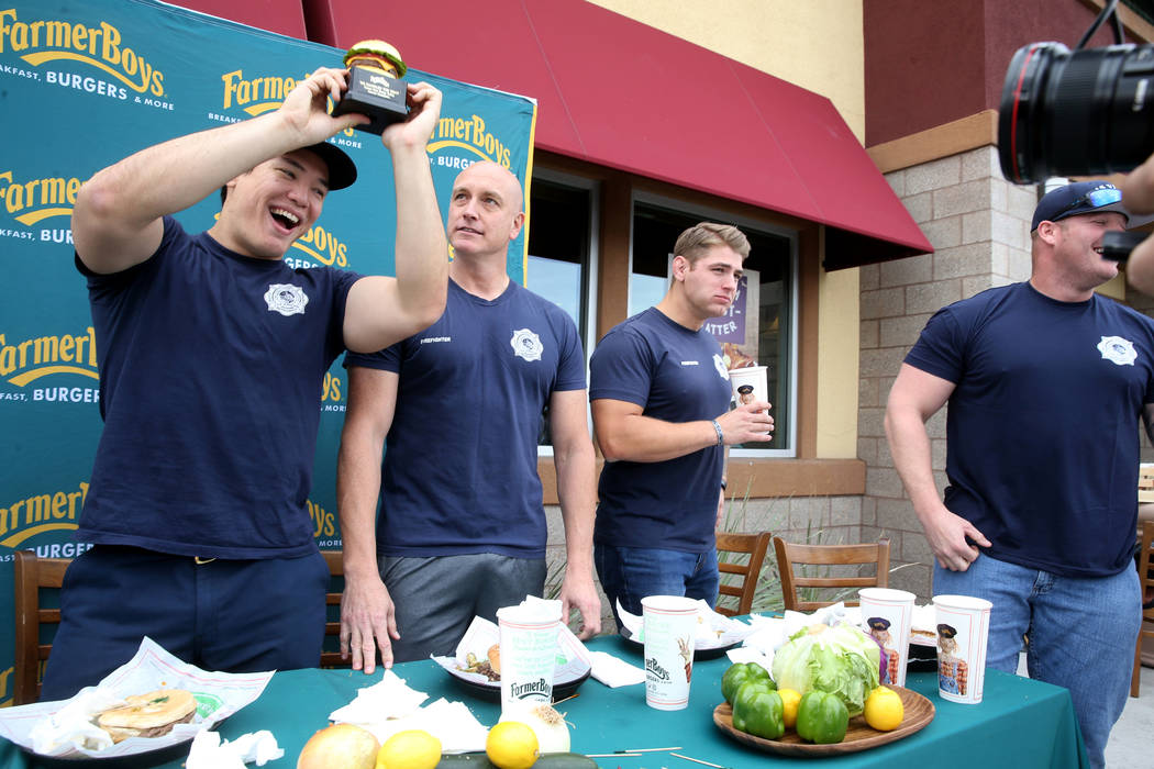 Las Vegas firefighters, from left, Toby Brown, Allen McFall, Kelby Lytle and Zach Lamboo celebr ...