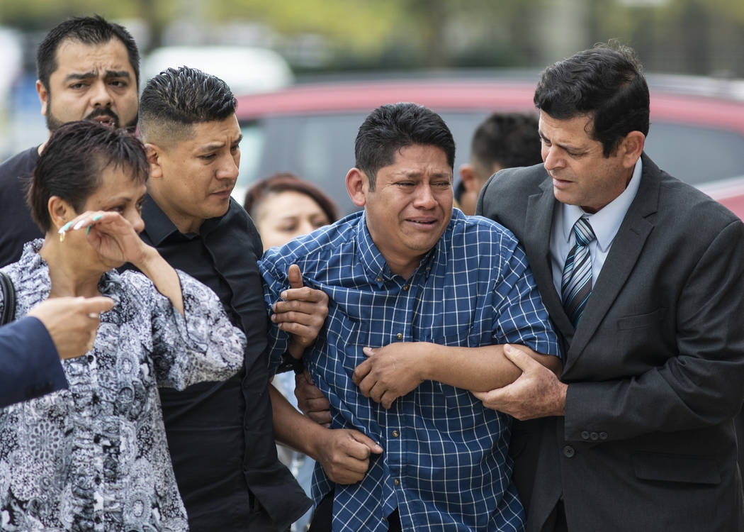 Arnulfo Ochoa, the father of Marlen Ochoa-Lopez, is surrounded by family members and supporters ...