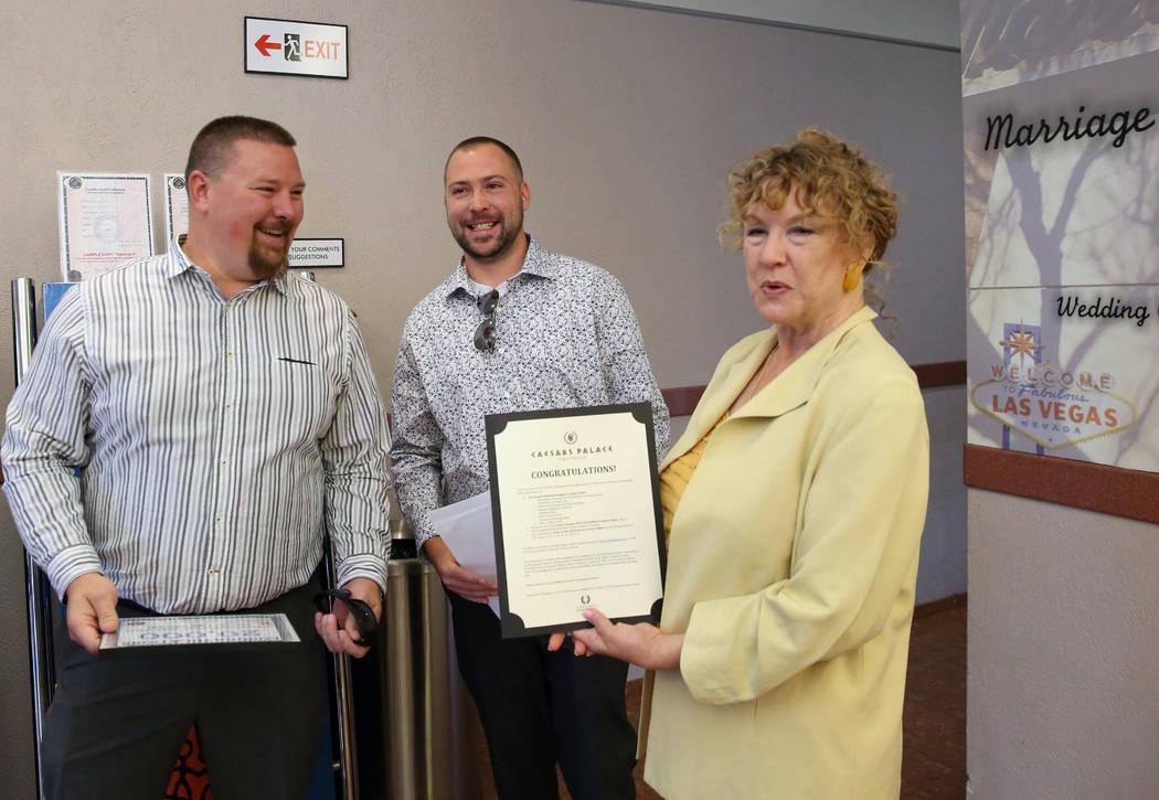County Clerk Lynn Goya, right, congratulates James Johnson, left, and his partner Matthew Tippl ...