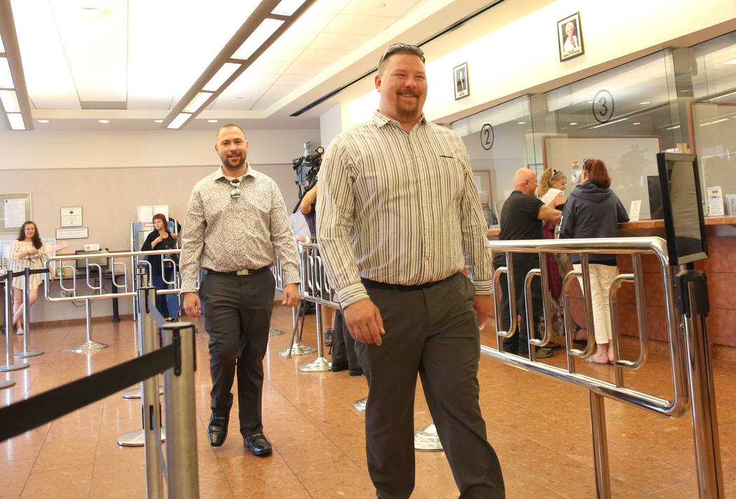 James Johnson, front, and his partner, Matthew Tipple, both of DeBary, Fla., arrive at the Clar ...