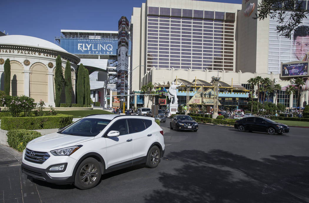 Cars pull into the self park lane at Caesars Palace on Thursday, May 16, 2019, in Las Vegas. (L ...