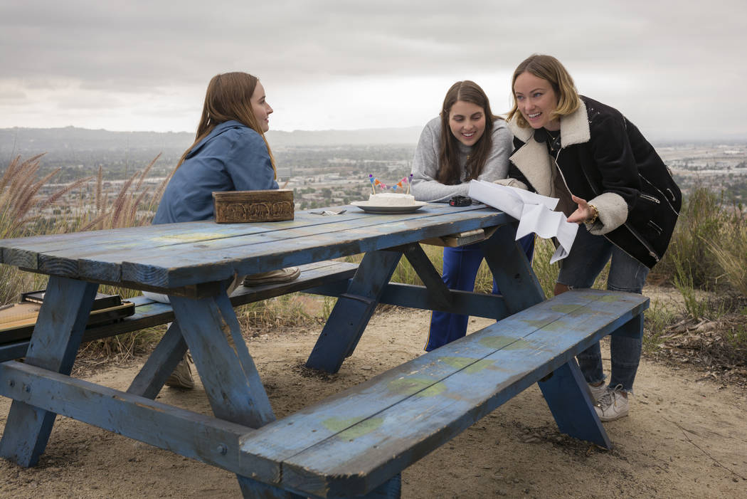 Kaitlyn Dever, left, and Beanie Feldstein with director Olivia Wilde on the set of Wilde's dire ...