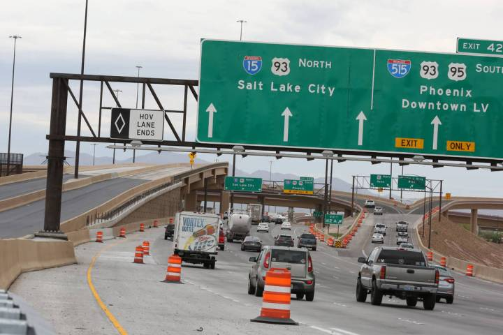 The newly completed Project Neon HOV flyover ramp in the Spaghetti Bowl, left, is seen on Thurs ...