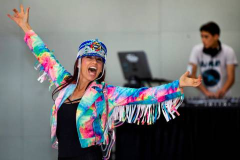 EDC traveler Carolina Woodruff of Jacksonville, Florida, dances as DJ Play performs for visitor ...