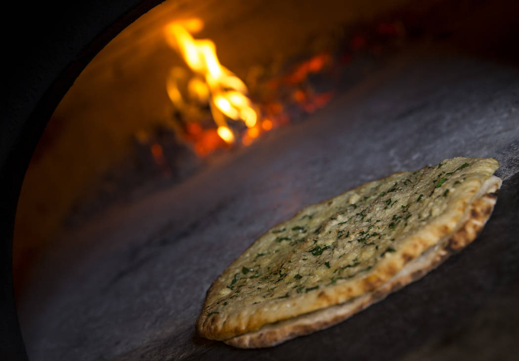 Recco style garlic bread in a wood fired oven at Masso Osteria inside Red Rock Casino in Las Ve ...