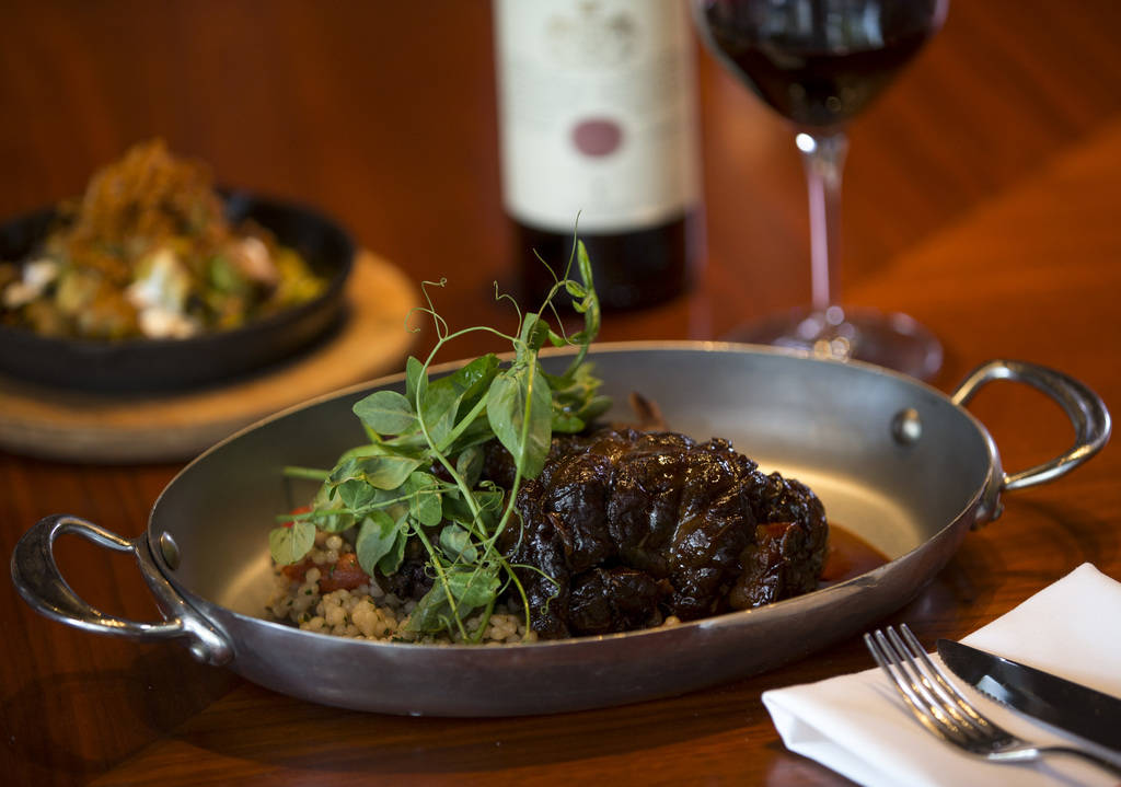 Lamb shank with Sardinian couscous, radicchio and anchovy lemon vinaigrette at Masso Osteria in ...