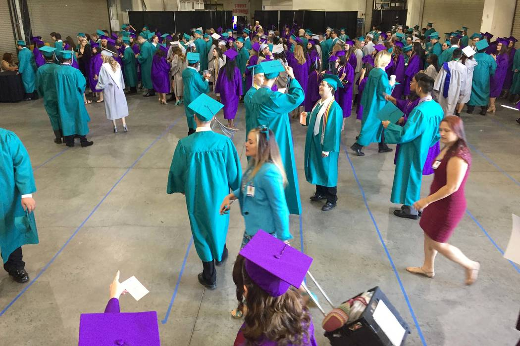 Silverado High School students congregate in a back room at Orleans Arena before graduation Wed ...