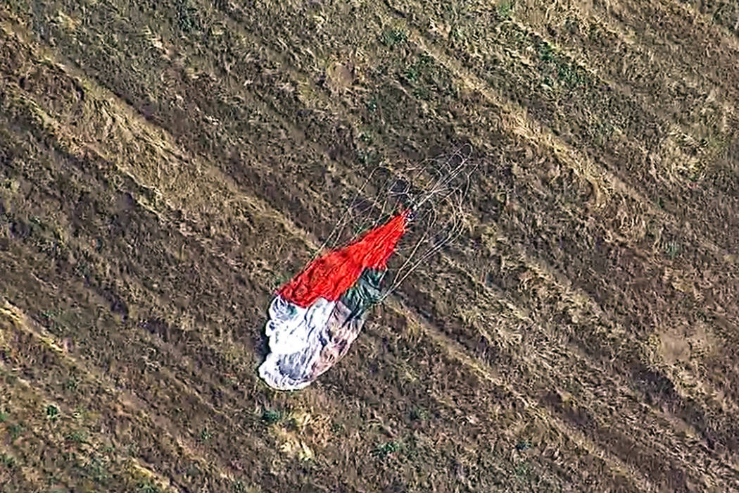 This photo taken from video provided by KABC-TV shows the parachute left by the pilot who eject ...