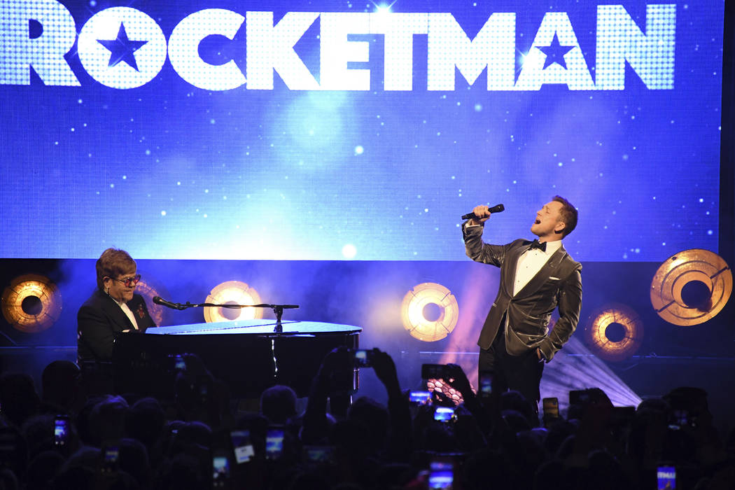 Singer Elton John, left, and actor Taron Egerton perform at the party for the film 'Rocketman' ...
