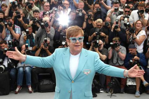 Singer Elton John poses for photographers at the photo call for the film 'Rocketman' at the 72n ...