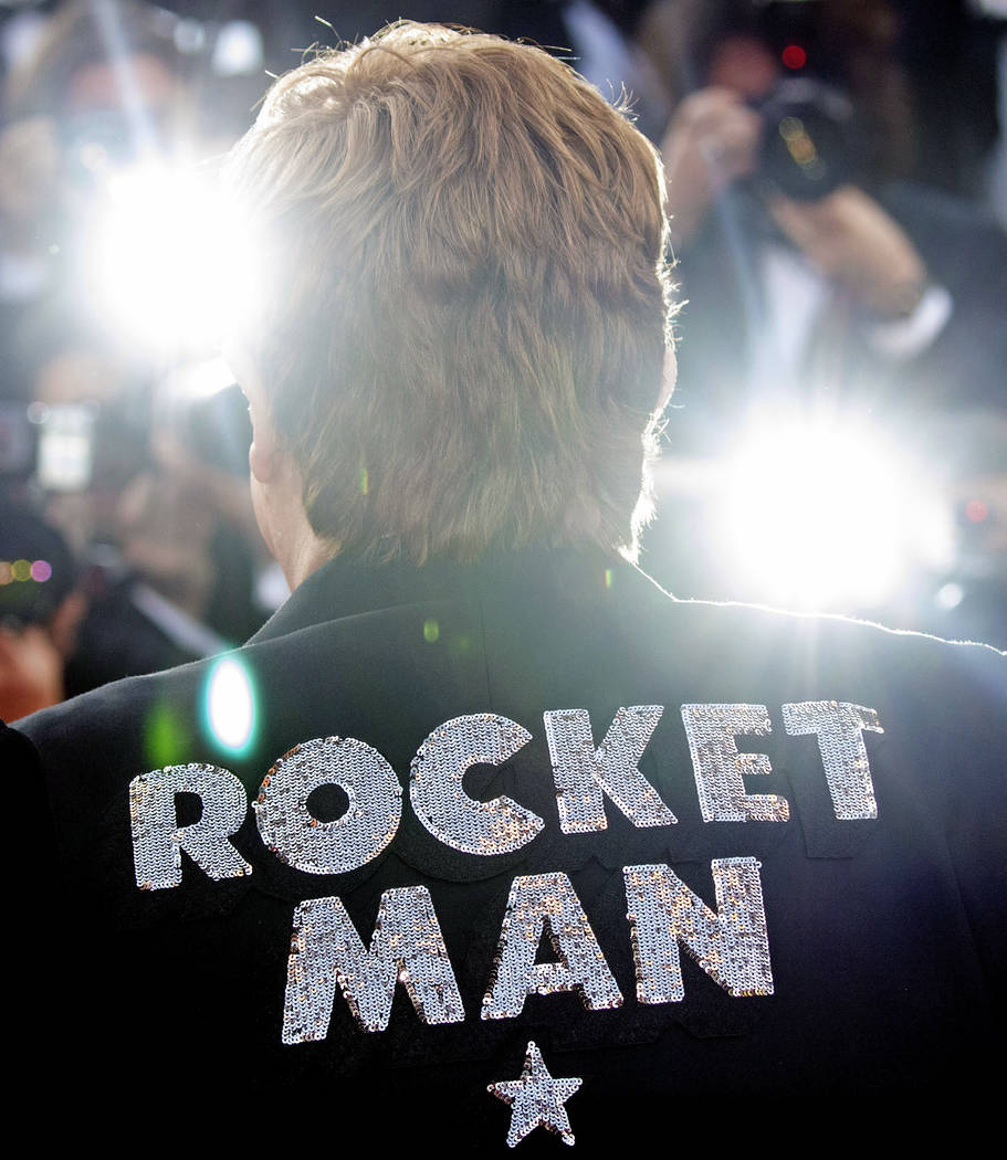 Musician Elton John poses for photographers upon his arrival at the premiere of the film 'Rocke ...