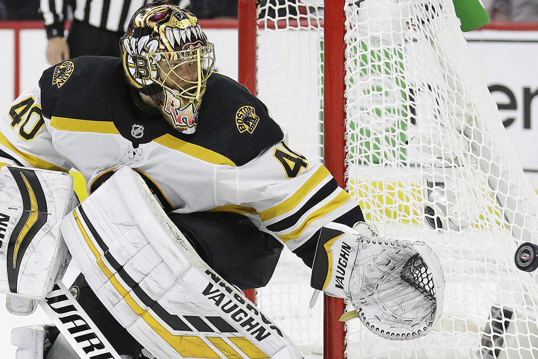 Boston Bruins goalie Tuukka Rask (40), of Finland, defends the goal against the Carolina Hurric ...