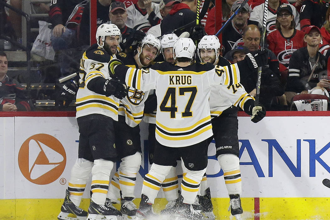Boston Bruins' Patrice Bergeron (37) David Pastrnak, second from left, Brad Marchand (63), Jake ...