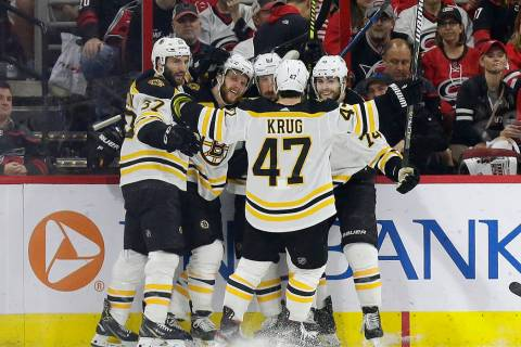 Boston Bruins' Patrice Bergeron (37) David Pastrnak, second from left, Brad Marchand (63), Jake ...