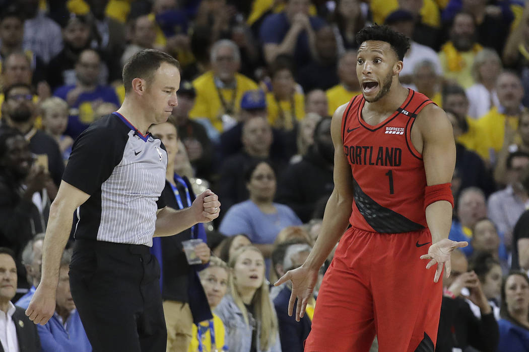 Portland Trail Blazers guard Evan Turner (1) gestures while talking to an official during the s ...