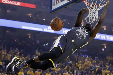 Golden State Warriors forward Draymond Green dunks against the Portland Trail Blazers during th ...