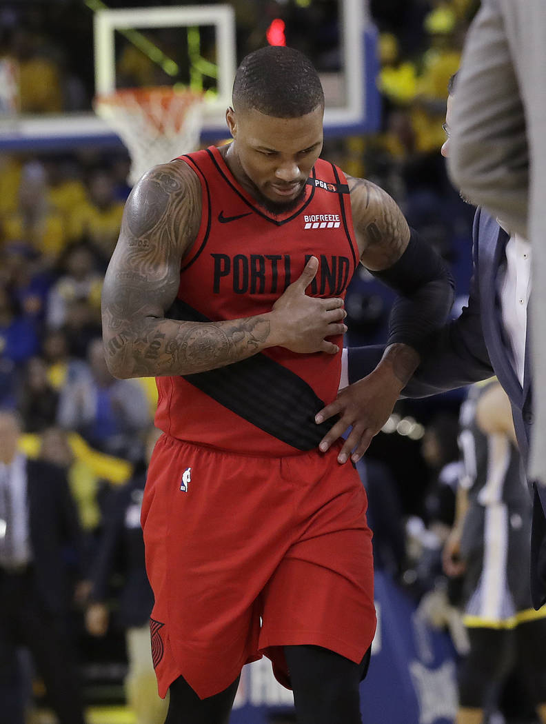 Portland Trail Blazers guard Damian Lillard walks to the bench during the second half of Game 2 ...
