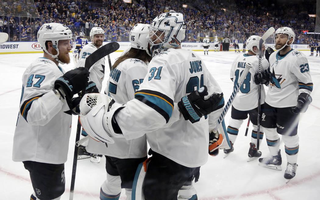 San Jose Sharks goaltender Martin Jones (31) celebrates with Joakim Ryan (47) and Erik Karlsson ...