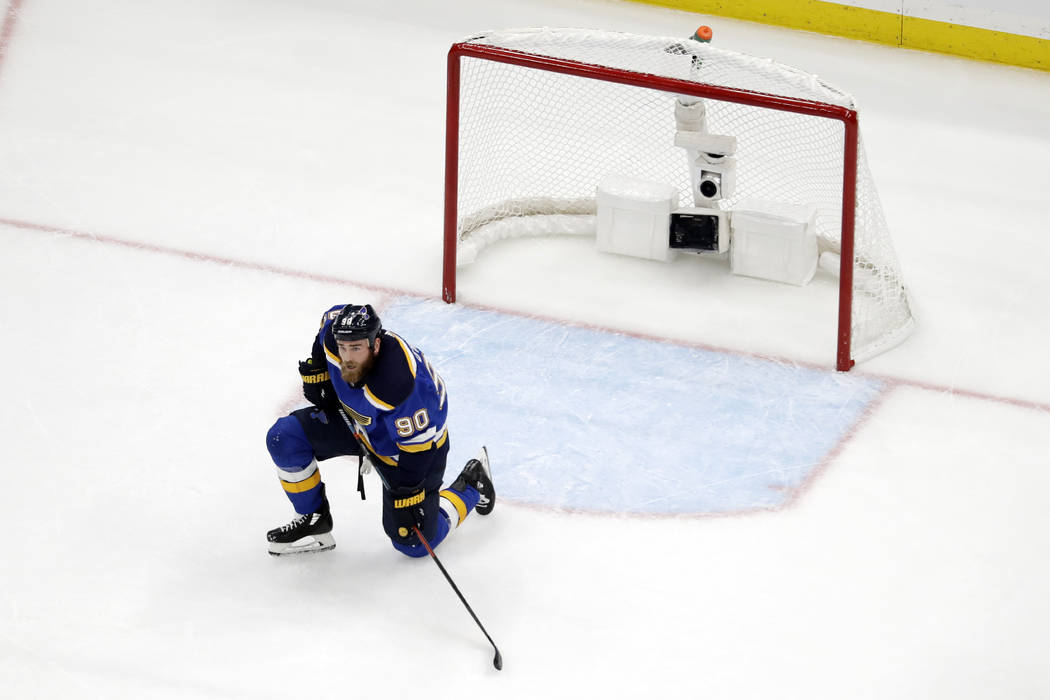 St. Louis Blues center Ryan O'Reilly (90) kneels by the net after the San Jose Sharks tied the ...