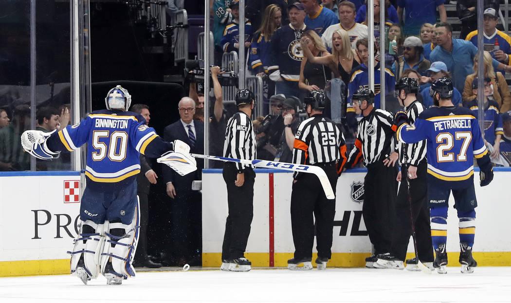 St. Louis Blues goaltender Jordan Binnington (50) and defenseman Alex Pietrangelo (27) argue ag ...
