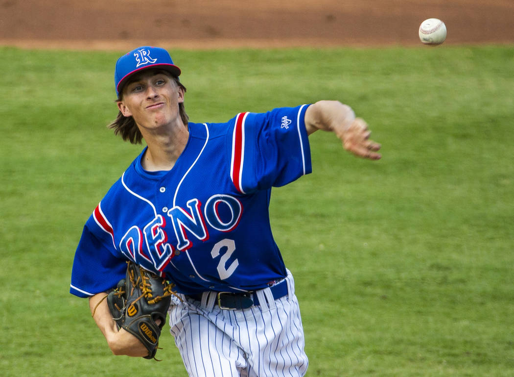 Reno pitcher John Barry (2) first a throw to a Desert Oasis batter in the first inning during t ...