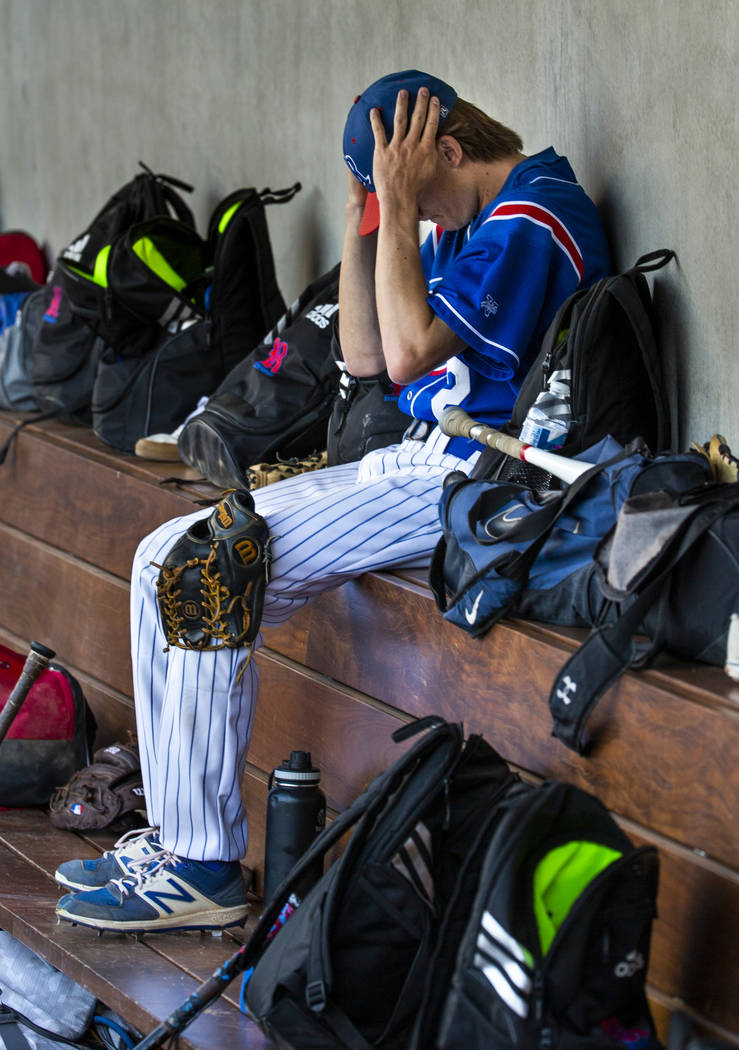Reno pitcher John Barry (2) gets his head straight in the dugout versus Desert Oasis in the fou ...