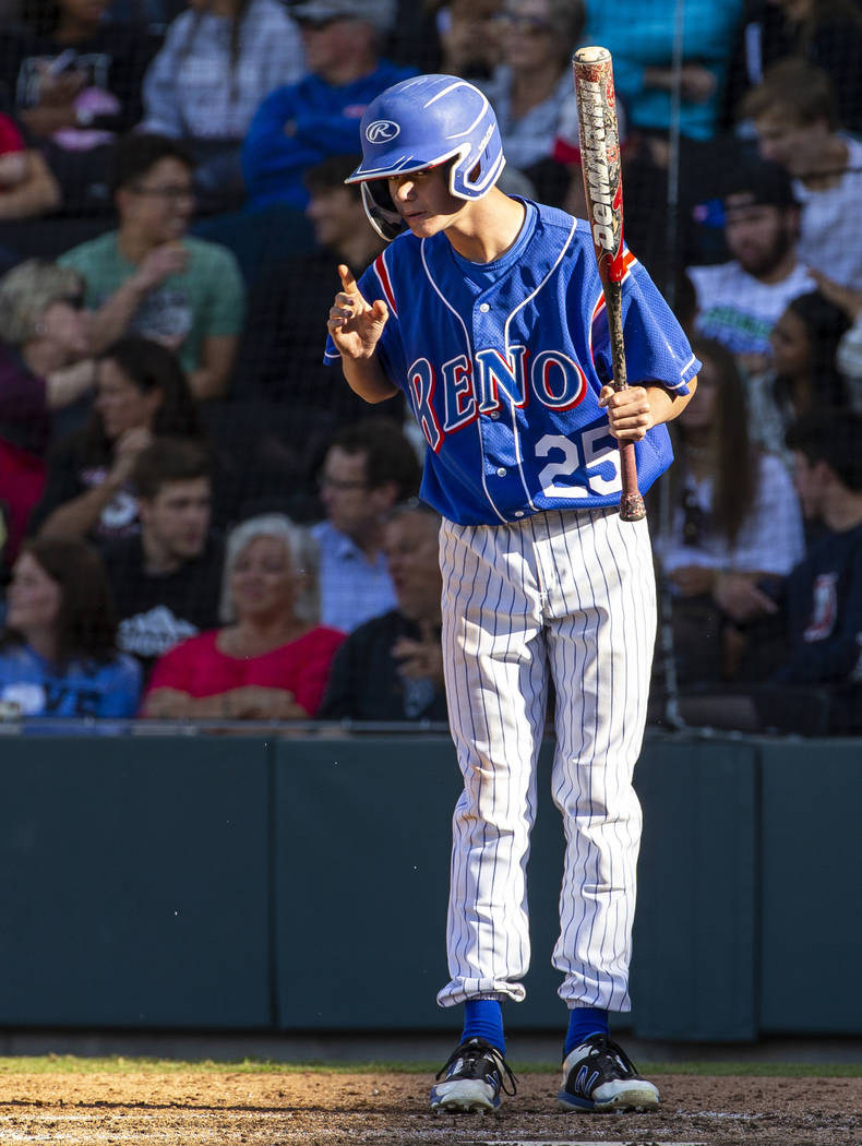 Reno batter Garryson Grinsell (25) takes direction from his coach versus Desert Oasis in the fo ...