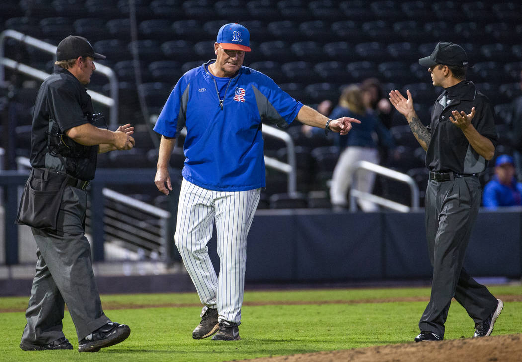 Reno head coach Pete Savage argues a call with the umpires versus Desert Oasis in the third inn ...