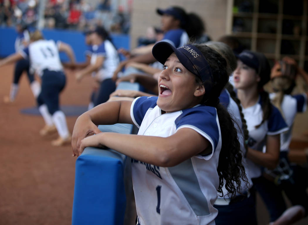 Shadow Ridge players including Kyanna Galvan (1) celebrate the go-ahead home run by Shea Clemen ...