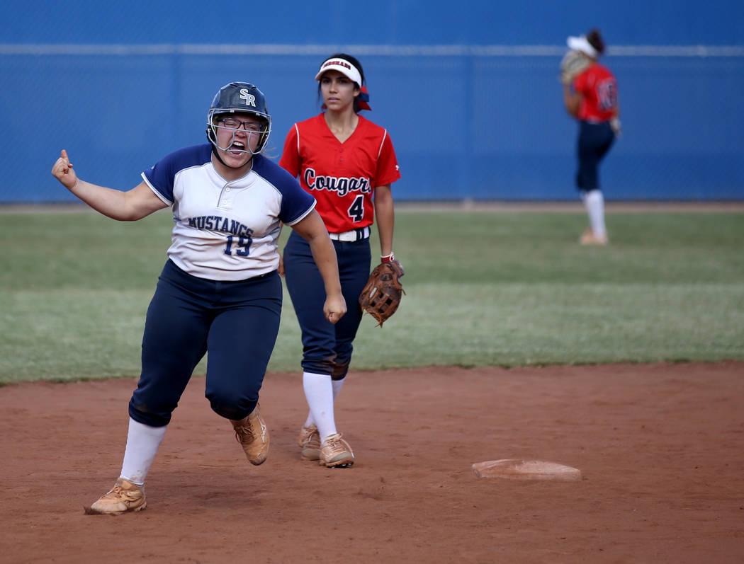 Shadow Ridge Sydney Morgan (19) celebrates her three-run home run against Coronado in their Cla ...