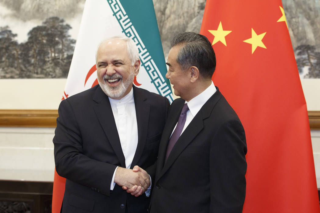 Chinese Foreign Minister Wang Yi meets Iranian Foreign Minister Mohammad Javad Zarif at the Dia ...