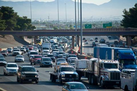 Traffic is backed up on southbound Interstate 15 in downtown Las Vegas as Electric Daisy Carniv ...