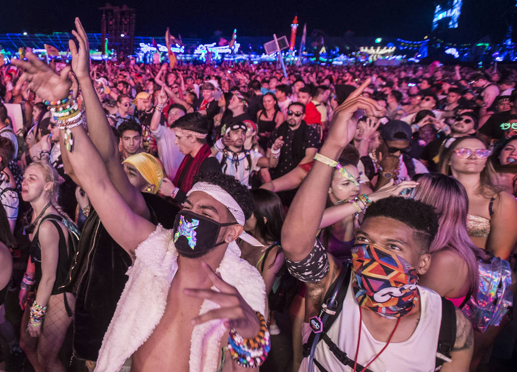 Concert goers dance at the Circuit Grounds stage during day two of Electric Daisy Carnival at L ...