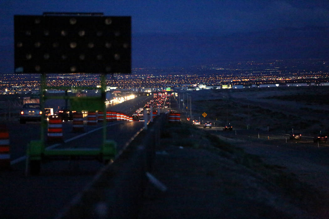 In the predawn hours attendees of the Electric Daisy Carnival begin heading south on Interstate ...
