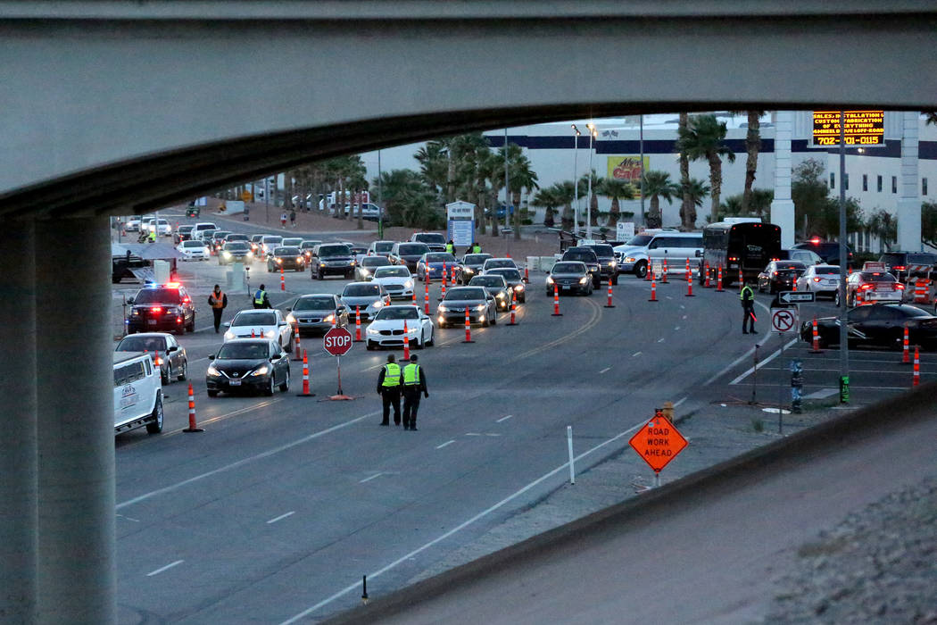 Attendees of the Electric Daisy Carnival begin exit the Las Vegas Motor Speedway as the festiva ...