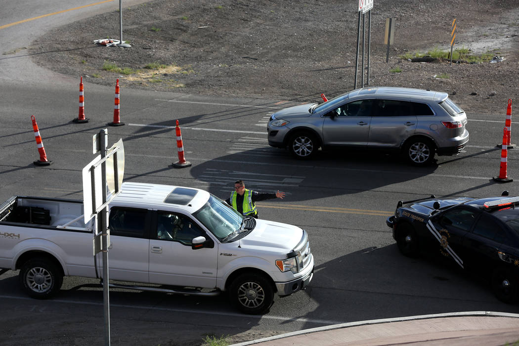A Nevada Highway Patrol Trooper manages traffic as attendees of the Electric Daisy Carnival exi ...