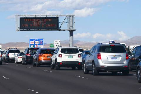 Traffic backs up on Interstate 15 as Electric Daisy Carnival attendees approach Speedway Boulev ...