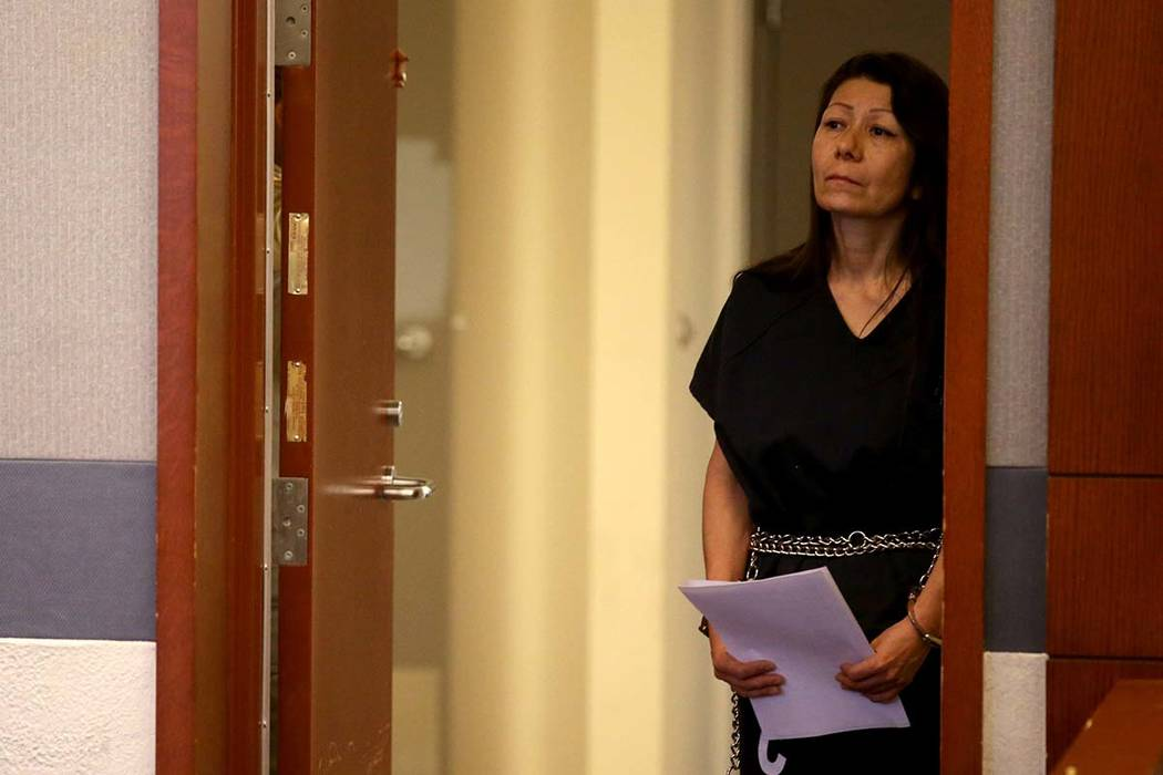Retired Las Vegas police detective Pamela Bordeaux remains in a holding cell entrance outside t ...