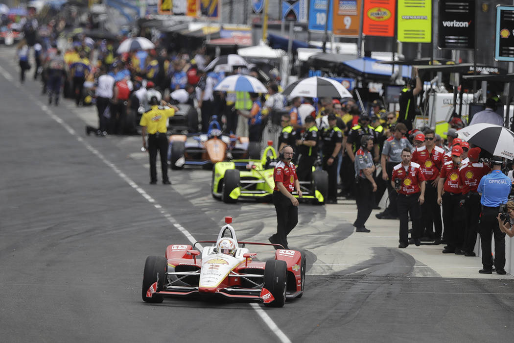 Josef Newgarden pulls out of the pits during practice for the Indianapolis 500 IndyCar auto rac ...