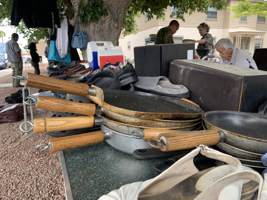 Residents of Desert Plaza Senior Apartments hold a yard sale to raise money for Serge Fournier' ...