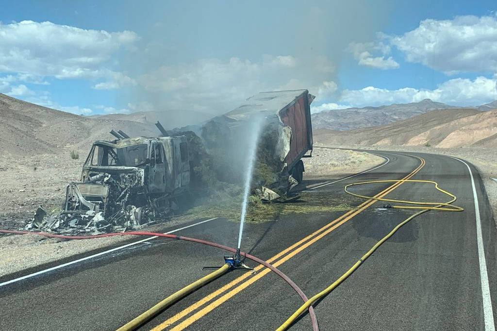 A hay truck burns in Death Valley National Park after the driver took a wrong turn and drove do ...