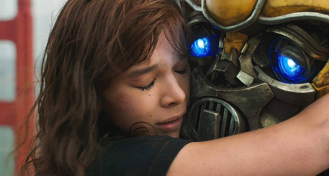 This image released by Paramount Pictures shows Hailee Steinfeld as Charlie and Bumblebee in a ...