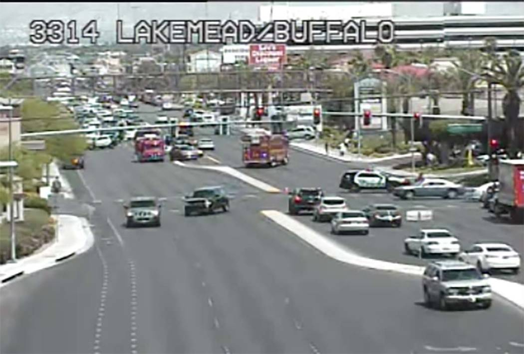 Las Vegas police investigate a crash at West Lake Mead Boulevard and North Buffalo Drive, Frida ...