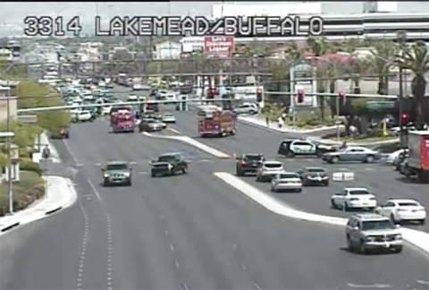 Las Vegas police investigate a crash at West Lake Mead Boulevard and North Buffalo Drive, Frida ...