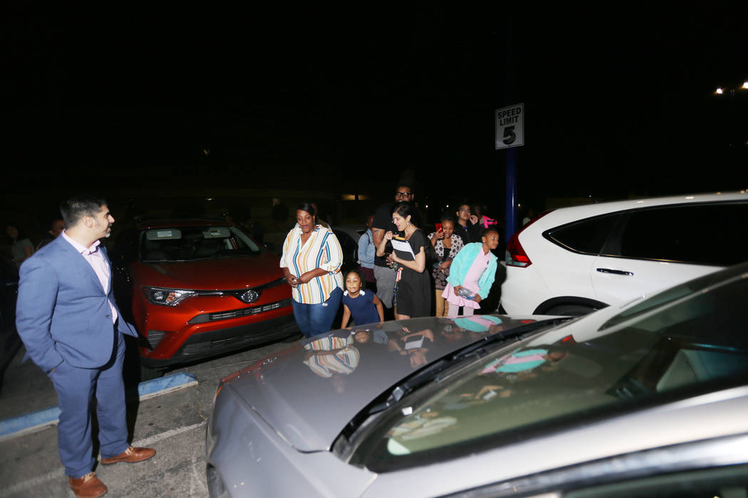 Principal John Anzalone, far left, waits for Tyria Smith to see her new car at Sierra Vista Hig ...