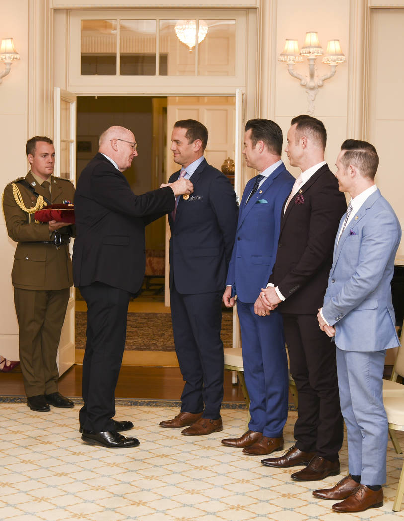 Peter Cosgrove, the Governor-General of the Commonwealth of Australia, awards members of Human ...