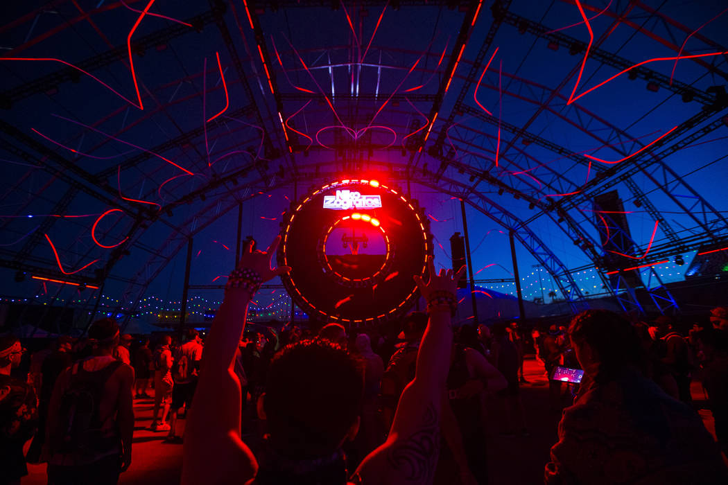 Attendees cheer as Niko Zografos performs at the Quantum Valley stage during the first day of t ...