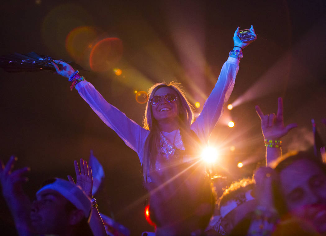 Attendees dance as Alesso performs at the Kinetic Field stage during the first day of the Elect ...